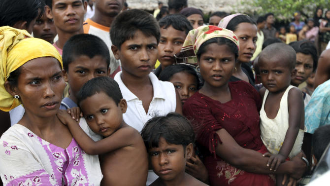 In this photo taken on Sept. 8, 2012, Muslims gather during a visit by a delegation of American diplomats including U.S. Ambassador to Myanmar Derek Mitchell, unseen, at a refugee camp in Sittwe, Rakhine State, western Myanmar. Three-and-a-half months after some of the bloodiest clashes in a generation between Myanmar's ethnic Rakhine Buddhists and stateless Muslims known as Rohingya left the western town of Sittwe in flames, nobody is quite sure when -or even if- the Rohingya will be allowed to resume the lives they once lived here. (AP Photo/Khin Maung Win)