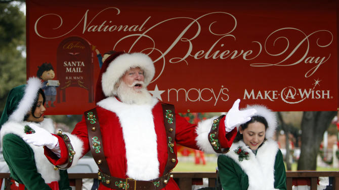 """Macy's Santa, with the help of his elves Sparkle and Jingle Belle, reads """" 'Twas the Night Before Christmas"""" during a visit to the Fort Worth Stockyards Friday, December 14, 2012. Macy's grants """"Wishes Across America"""" on National Believe Day and brings Santa to Dallas and Fort Worth for Macy's National Santa Tour. (Richard W. Rodriguez /AP Images for Macy's)"""