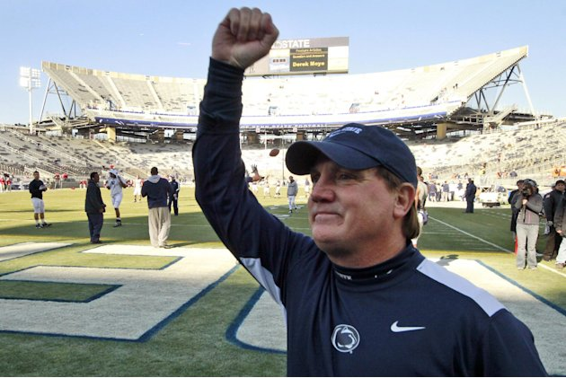 Penn State interim head coach Tom Bradley acknowledges the student section during warm ups before an NCAA college football game against Nebraska in State College, Pa., Saturday, Nov. 12, 2011. (AP Pho