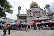 Vendors sell Muslim food during the month of Ramadan outside the Sultan mosque in Singapore. Spending by Muslim tourists is growing faster than the global rate and is forecast to reach $192bn a year by 2020, up from $126bn in 2011, according to a study