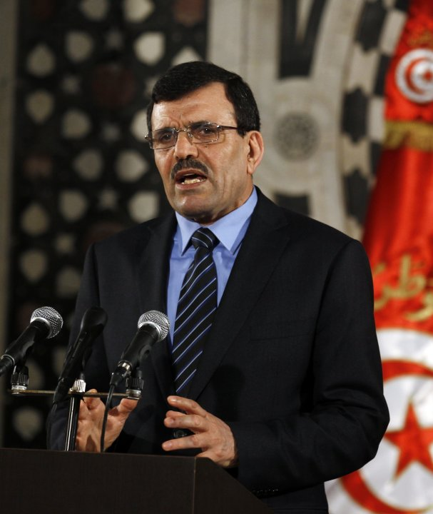 Tunisia's Prime Minister Ali Larayedh speaks during a news conference in Tunis