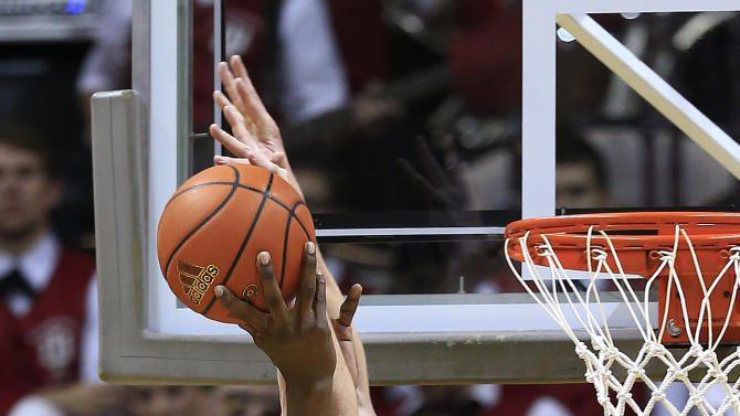 Indiana's Cody Zeller, right, blocks the shot of Minnesota's Trevor Mbakwe during the second half of an NCAA college basketball game, Saturday, Jan. 12, 2013, in Bloomington, Ind. Indiana defeated Minnesota 88-81. (AP Photo/Darron Cummings)