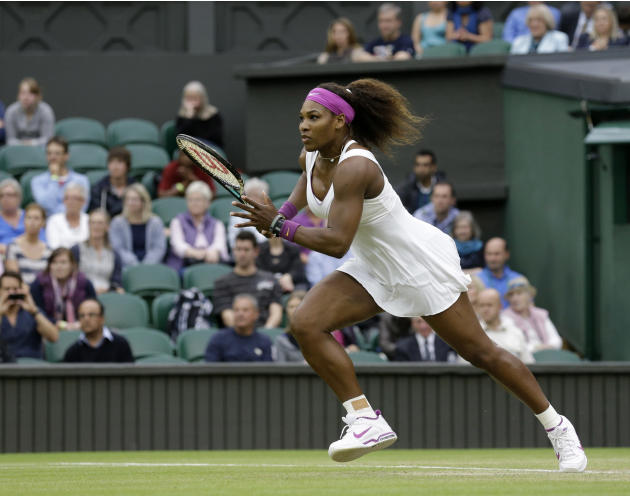 Serena Williams of the United States runs to play a return to Petra Kvitova of the Czech Republic during a quarterfinals match at the All England Lawn Tennis Championships at Wimbledon, England, Tuesd