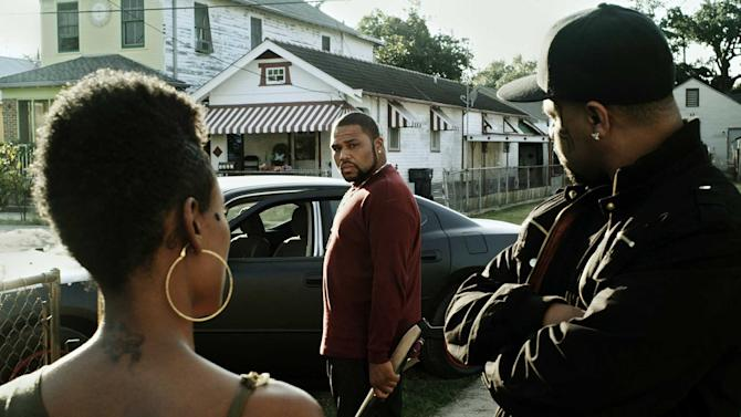 "This film image released by Steelyard Pictures shows Anthony Anderson in a scene from ""The Power of Few,"" an independent action-drama filmed in New Orleans. Anderson, star of the NBC sitcom ""Guys With Kids,"" sheds his funnyman persona to play a tattoo-faced, gun-wielding thug making its limited-release debut on Friday, Feb. 22, 2013. (AP Photo/Steelyard Pictures)"