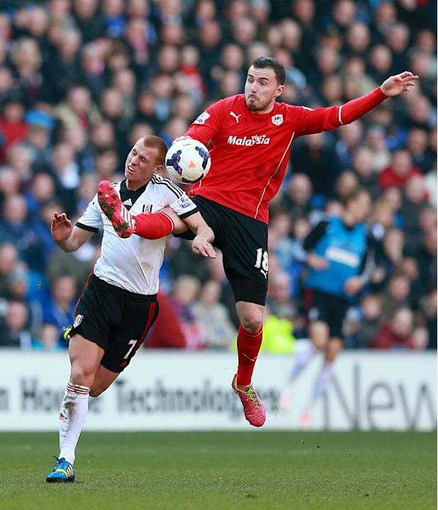Fulham's Steve Sidwell, left and Cardiff City's Jordon Mutch battle for the ball during their English Premier League soccer match at Cardiff City Stadium, Cardiff, Wales, Saturday, March 8, 20