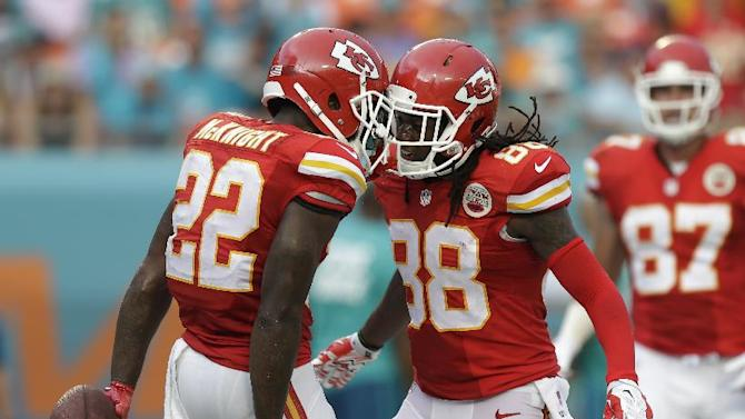 Kansas City Chiefs running back Joe McKnight (22) celebrates with Kansas City Chiefs wide receiver Junior Hemingway (88) after Mc Knight scored a touchdown during the second half of an NFL football game against the Miami Dolphins, Sunday, Sept. 21, 2014, in Miami Gardens, Fla