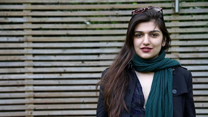 "This 2012 photo provided by the Free Ghoncheh Campaign, shows Iranian-British Ghoncheh Ghavami posing for a photograph in London, England. Ghavami detained while trying to attend a men's volleyball game has been sentenced to one year in prison, her lawyer said Sunday, Nov. 2, 2014. Mahmoud Alizadeh Tabatabaei told The Associated Press that a court found Ghavami, 25, guilty of ""propagating against the ruling system."" (AP Photo/Free Ghoncheh Campaign)"