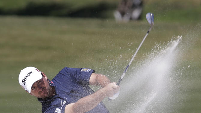Graeme McDowell of Northern Ireland hits from an 11th fairway sand trap during the second round of the Cadillac Championship golf tournament Friday, March 8, 2013, in Doral, Fla. (AP Photo/Alan Diaz)