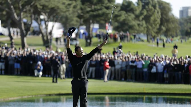 Tiger Woods celebrates after his victory in the Farmers Insurance Open golf tournament Monday, Jan. 28, 2013, at Torrey Pines Golf course in San Diego. (AP Photo/Gregory Bull)