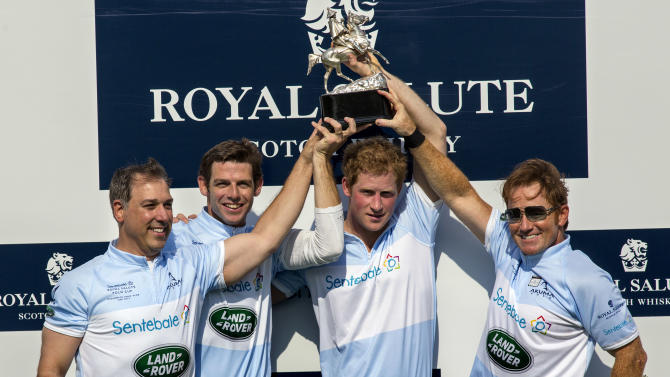 Britain's Prince Harry, center right, and teammates, from left, Michael Carrazza, Malcolm Borwick, and Marc Ganzi, pose with the trophy after winning the Sentebale Royal Salute Polo Cup charity match in Greenwich, Conn., Wednesday, May 15, 2013. (AP Photo/Craig Ruttle)
