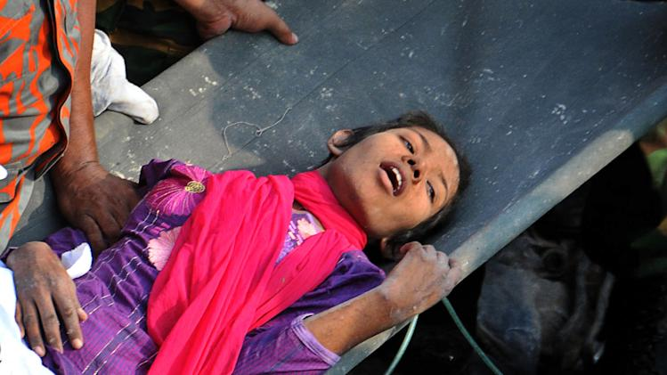 Finding woman alive lifts Bangladesh rescuers