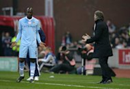 Roberto Mancini (right) and Mario Balotelli