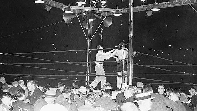 4. Joe Louis TKO1 Max Schmeling, June 22, 1938 – With tensions rising between the U.S. and Germany because of the Hitler regime's aggressive foreign policy, the fight had societal, as well as sporting implications. Schmeling had beaten Louis in 1936 and Americans badly wanted to see Louis get revenge. He did so in a big way, knocking Schmeling down three times in the first, forcing referee Arthur Donovan to stop it. (Photo credit: Getty)