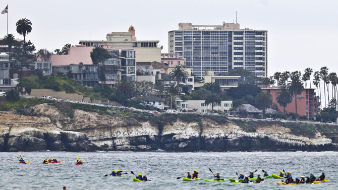 Birds spot the white cliffs above the cove in the La Jolla section of San Diego, Wednesday, April 3, 2013. While tourist are still drawn to the area the birds have turned the cliffs white with their dropping and are causing a stench in the area with numerous restaurants and hotels. (APPhoto/Lenny Ignelzi)