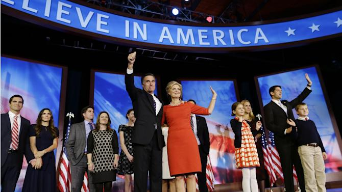 Standing with their families, Republican presidential candidate and former Massachusetts Gov. Mitt Romney stands with his wife Ann, and Republican vice presidential candidate Rep. Paul Ryan, R-Wis., second right, stands with his wife Janna after Romney's concession speech at his election night rally in Boston, Wednesday, Nov. 7, 2012. (AP Photo/Charles Dharapak)