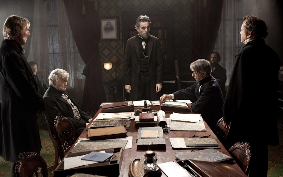 "FILE - This undated publicity photo released by DreamWorks and Twentieth Century Fox shows, Daniel Day-Lewis, center rear, as Abraham Lincoln, in a scene from the film, ""Lincoln."" (AP Photo/DreamWorks, Twentieth Century Fox, David James, File)"