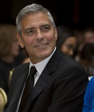 Actor George Clooney, pictured in April 2012, will hold star-studded event in honor of US President Barack Obama, promising a campaign windfall of up to $15 million