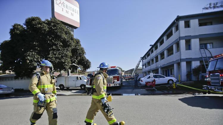 Firefightersrespond to the Heritage Hotel after an explosion on Wednesday, Jan. 30, 2013, in San Diego. The cause of the explosion is under investigation.  Three people were injured in the explosion at the hotel near SeaWorld San Diego and investigators were trying to determine whether there was a drug lab inside, authorities said.  Three people were taken to a hospital to be treated for burns and one was in serious condition, said San Diego Fire-Rescue Department spokesman Maurice Luque.   (AP Photo/Lenny Ignelzi)