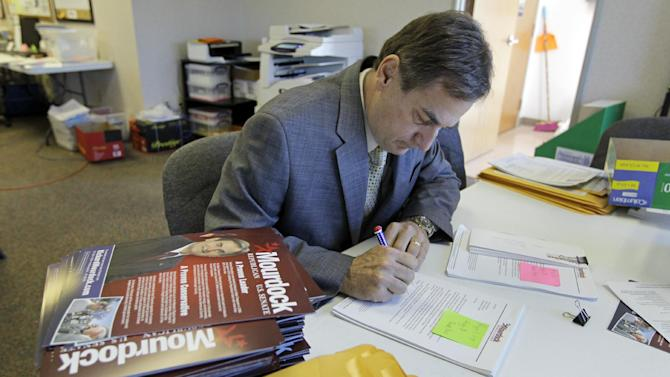In this April 27, 2012, photo, Richard Mourdock, Indiana Treasurer and candidate for the U.S. Senate in the republican primary, signs thank you letters for donations to his campaign at an office in Indianapolis. Mourdock faces incumbent Richard Lugar in the primary. (AP Photo/Michael Conroy)