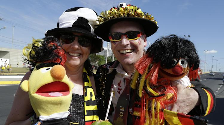 German soccer team fans hold Ernie and Bert puppets as they arrive for the group G World Cup soccer match between Germany and Ghana at the Arena Castelao in Fortaleza, Brazil, Saturday, June 21, 2014. (AP Photo/Themba Hadebe)