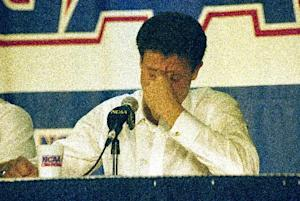 "FILE - In this March 28, 1992, file photo, Kentucky head coach Rick Pitino reacts during the end of the East Regional Final NCAA college basketball game news conference following their 104-103 overtime loss to Duke in Philadelphia. For the first time since Christian Laettner's improbable buzzer-beater, head coaches Mike Krzyzewski and Pitino are meeting in the regional finals of the NCAA tournament. Pitino is across the state in Louisville these days, but that doesn't lessen the drama of their long-awaited ""rematch."" (AP Photo/Charles Rex Arbogast, File)"