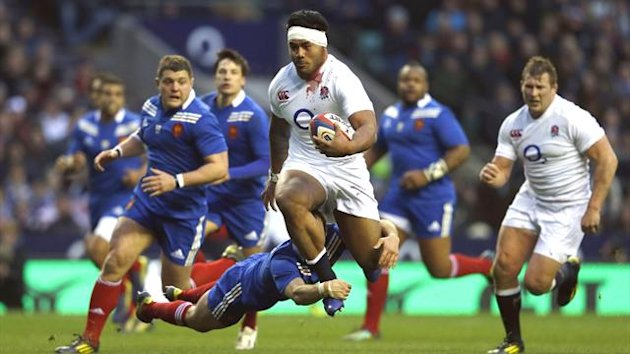 Manu Tuilagi makes a break for England against France (Reuters)