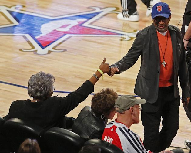 Vice Chairwoman of the Democratic National Committee Donna Brazile, left fist bumps Director Spike Lee before the skills competition at the NBA All Star basketball game, Saturday, Feb. 15, 2014, in Ne
