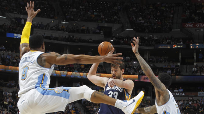 Memphis Grizzlies center Marc Gasol, center, of Spain, looks to pass the ball under pressure from Denver Nuggets guard Andre Iguodala, front left, and forward Wilson Chandler in the first quarter of an NBA basketball game in Denver, Friday, March 15, 2013. (AP Photo/David Zalubowski)