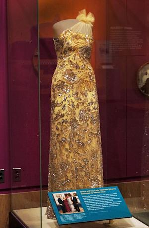 """This handout photo provided by the Smithsonian shows a dress designed by Indian-American designer Naeem Khan for first lady Michelle Obama. It was worn to the 2012 Governors Dinner and is now on display at the Smithsonian's first major exhibit: """"Beyond Bollywood: Indian Americans Shape the Nation"""" on Indian-American influences in U.S. history. Khan has designed several dresses for Mrs. Obama. The exhibit opens Thursday. (AP Photo/Smithsonian)"""
