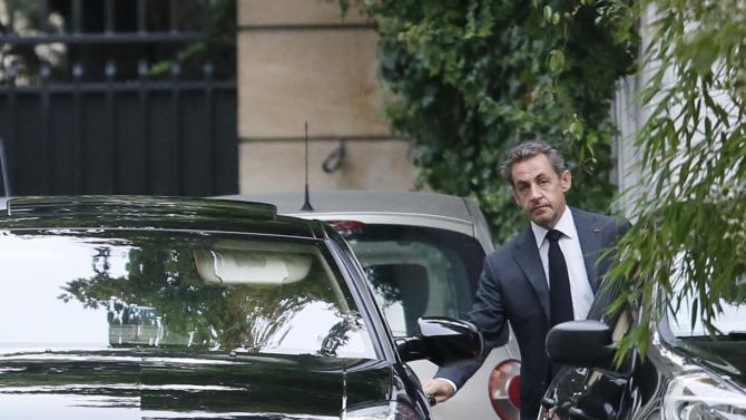 Former French President Sarkozy leaves his residence in Paris