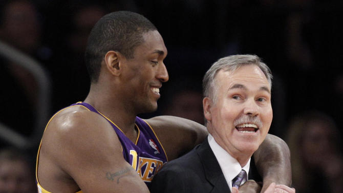Los Angeles Lakers forward Metta World Peace (15) embraces Los Angeles Lakers head coach Mike D'Antoni in the first half of their NBA basketball game at Madison Square Garden in New York, Thursday, Dec. 13, 2012.  It was D'Antoni's first time back in Madison Square Garden since he resigned. (AP Photo/Kathy Willens)