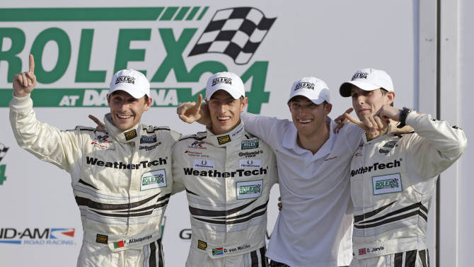 GT Class winning drivers, from left, Filipe Albuquerque, of Portugal, Dion von Moltke, Edoardo Montara, of Switzerland, and Oliver Jarvis, of England, celebrate in Victory Lane after winning their class in the Grand-Am Series Rolex 24 hour auto race at Daytona International Speedway, Sunday, Jan. 27, 2013, in Daytona Beach, Fla. (AP Photo/John Raoux)