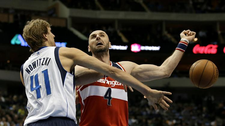Nowitzki passes West, Mavericks top Wizards 105-95