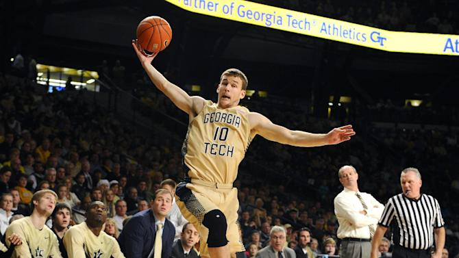 Georgia Tech guard Travis Jorgenson (10) saves the ball from going out of bounds against Vanderbilt during the first half of their NCAA college basketball game Saturday, Dec. 20, 2014, in Atlanta. (AP Photo/David Tulis)