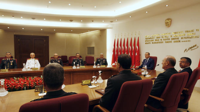 Gen. Necdet Ozel, Turkey's newly appointed Land Forces Commander and acting Chief of Staff, fifth from left in back, attends a key military council meeting chaired by Turkish Prime Minister Recep Tayyip Erdogan, third from right, in Ankara, Turkey, Monday, Aug. 1, 2011. Turkish Chief of Staff Gen. Isik Kosaner and the commanders of the navy, the army and the air force suddenly resigned Friday, July 29 to protest the arrest of dozens of generals as suspects in an alleged plot to overthrow the country's Islamic-rooted government. Many have questioned whether such a plot ever existed and see the arrests as part of Erdogan's long-standing campaign to establish civilian authority over Turkey's once powerful military. (AP Photo/Burhan Ozbilici)