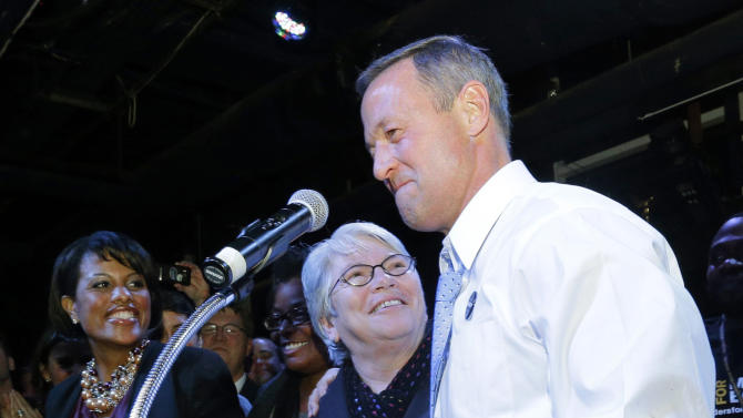 FILE - This Nov. 6, 2012 file photo shows Baltimore Mayor Stephanie Rawlings-Blake, left, Maryland State Rep. Maggie McIntosh, D-Baltimore City, center and Maryland Gov. Martin O'Malley celebrating onstage at an Election Night party in Baltimore, after voters passed a referendum approving same sex marriage in Maryland.  Voters also altered the course of U.S. social policy, voting in Maine and Maryland to approve same-sex marriage, while Washington state and Colorado voted to legalize recreational use of marijuana. (AP Photo/Patrick Semansky, File)