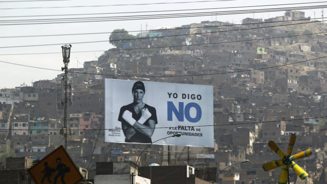 "In this Feb. 12, 2013 photo, a sign supporting Lima's Mayor Susana Villaran, showing WBA Super Featherweight Champion Kina Malpartida and the words ""I say NO to to the lack of opportunities"" stands near a shanty town in Lima, Peru. Villaran, a 63-year-old career human rights defender and the first woman ever elected to manage Peru's capital, will face a recall election on March 17. With her November 2010 election, the left returned to Lima's City Hall for the first time in 23 years. The conservative she defeated, Lourdes Flores, opposes the recall, along with President Ollanta Humala and leading intellectuals, actors, artists and athletes. (AP Photo/Martin Mejia)"