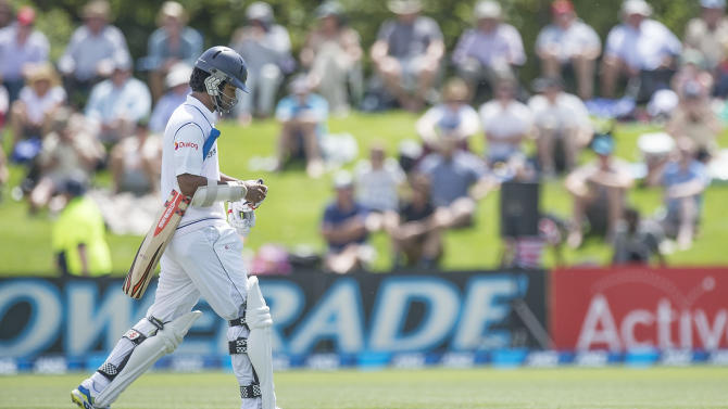 Sri Lanka's Dimuth Karaunaratne walks from the field after being caught out during day two of the 1st International Test cricket match between New Zealand and Sri Lanka in Christchurch at Hagley Park Oval on December 27, 2014
