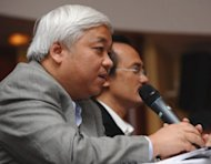 This picture taken on February 16, 2012 shows Nguyen Duc Kien speaking at a soccer event in Hanoi. VNervous Vietnamese have pulled hundreds of millions of dollars from the banking system after the flamboyant financier was arrested for fraud, state media reported Thursday