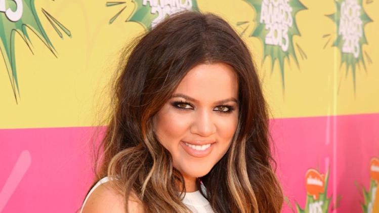 FILE - This March 23, 2013 file photo shows TV personality Khloé Kardashian at the 26th annual Nickelodeon's Kids' Choice Awards in Los Angeles.  (Photo by Todd Williamson/Invision/AP, file)