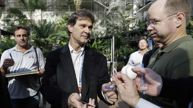 Los Angeles Dodgers manager and former Yankee Don Mattingly, center, signs autographs for fans at the baseball winter meetings on Monday, Dec. 3, 2012, in Nashville, Tenn. (AP Photo/Mark Humphrey)