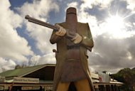 File photo of a giant statue of Australian outlaw Ned Kelly at Glenrowan, the location of his final stand, north of Melbourne. The headless remains of infamous Australian outlaw Ned Kelly are to be returned to his descendants for a family burial 132 years after the notorious criminal was executed, officials said Thursday