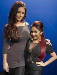 "FILE - This Feb. 1, 2012 file photo shows Jenni ""JWoww"" Farley, left, and Nicole ""Snooki"" Polizzi from the MTV series ""Jersey Shore,"" pose for a portrait in New York. Polizzi is expecting her first child with fiance Jionni LaValle and is due in September. She said she was in her first trimester while filming her ""Jersey Shore"" spin-off TV show with Jenni ""JWoww"" Farley called ""Snooki and JWoww."" (AP Photo/Charles Sykes, file)"