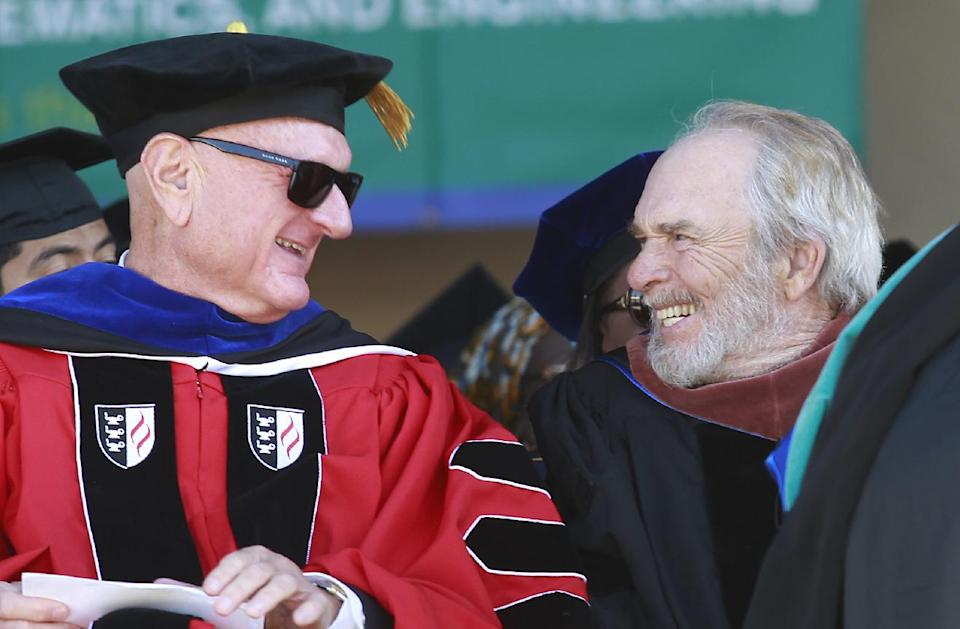 Dr. Merle Haggard, right, shares a laugh with fellow doctor, and California State University Trustee, Douglas Faigin at California State University, Bakersfield on Friday June 14, 2013. (AP photo/The Bakersfield Californian, Felix Adamo)