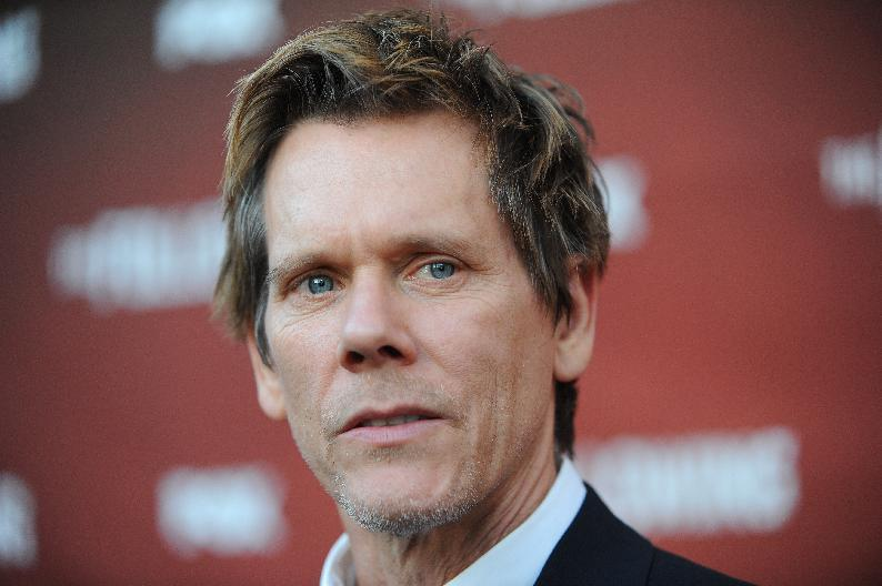 "Kevin Bacon arrives at the Academy Screening and Q and A for ""The Following"" at the Leonard H. Goldenson Theatre on Monday, April 29, 2013 in North Hollywood, Calif. (Photo by Richard Shotwell/Invision/AP)"