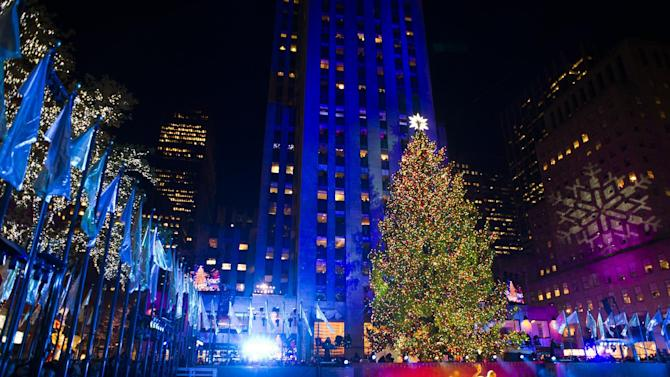 FILE - In a Wednesday, Nov. 28, 2012 file photo, the 80-foot-tall Rockefeller Center Christmas tree is lit using 45,000 energy efficient LED lights during the 80th annual lighting ceremony in New York. The tree comes from the Mount Olive, N.J., home of Joe Balku, who lost power and other trees during the storm. It's now covered in 30,000 lights and will remain on view until Jan. 7. While you're at Rock Center, watch the ice skaters, take in the Radio City Christmas Spectacular or visit St. Patrick's Cathedral on Fifth Avenue.(Photo by Charles Sykes/Invision/AP, File)