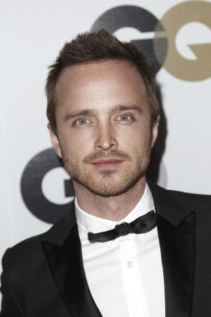 """FILE - In this Nov. 17, 2011 file photo, actor Aaron Paul arrives at the 16th annual GQ """"Men of the Year"""" party in Los Angeles. Paul tweeted this week that he was burglarized twice while shooting his hit series """"Breaking Bad,"""" in Albuquerque. (AP Photo/Matt Sayles, file)"""