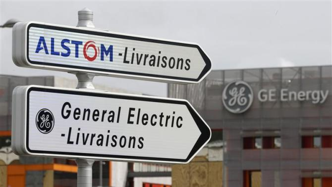 Road signs indicate directions for deliveries to French power and transport engineering company Alstom and US conglomerate General Electric sites in Belfort