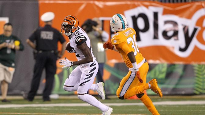 A.J. Green of the Cincinnati Bengals had eight catches for 123 yards and caught a seven-yard touchdown toss just in the first half