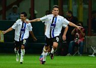 Atalanta's midfielder Luca Cigarini celebrates after scoring during the Italian serie A football match at San Siro stadium in Milan. AC Milan warmed up for their Champions League group opener against Anderlecht on Tuesday by suffering a shock 1-0 home defeat to strugglers Atalanta